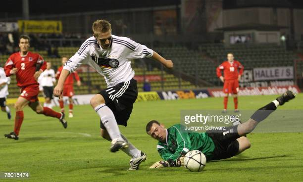 Rouwen Hennings of Germany and goalkeeper Jeff Oster of Luxembourg fight for the ball during the U21 qualifier between Luxembourg and Germany at the...