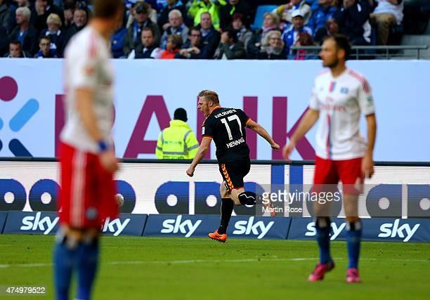 Rouwen Hennings of Karlsruhe celebrates after scoring the opening goal during Bundesliga first leg play off match between Hamburger SV and Karlsruher...