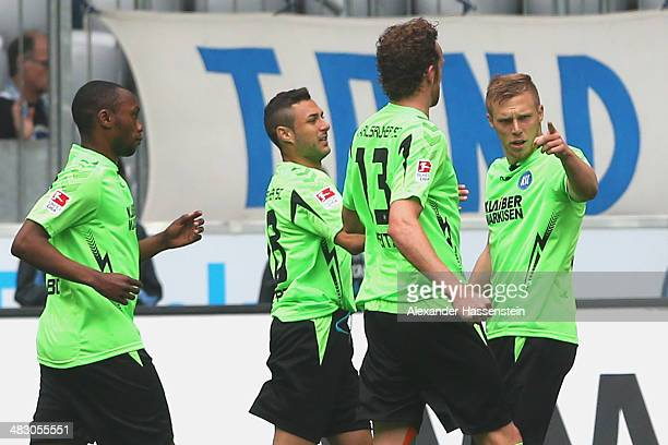 Rouwen Hennings of Karlsruhe celebrates scoring the opening goal with his team mates during the Second Bundesliga League match between 1860 Muenchen...