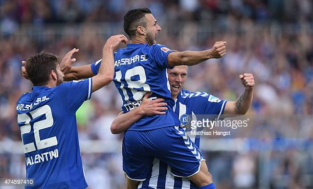 Rouwen Hennings of Karlsruhe celebrates with his teammates after scoring his team's first goal during the Second Bundesliga match between Karlsruher...