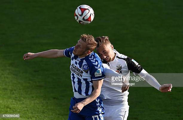 Rouwen Hennings of Karlsruhe jumps for a header with Florian Huebner of Sandhausen during the Second Bundesliga match between SV Sandhausen and...