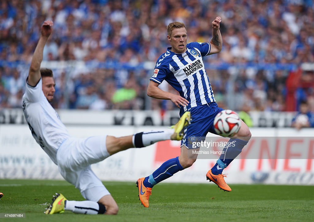 Rouwen Hennings of Karlsruhe scores his team's first goal during the Second Bundesliga match between Karlsruher SC and 1860 Muenchen the at Wildpark...