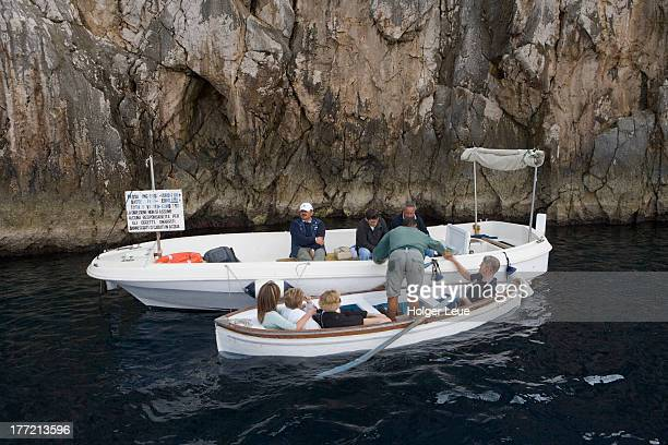 Row boat and toll collection boat at Blue Grotto