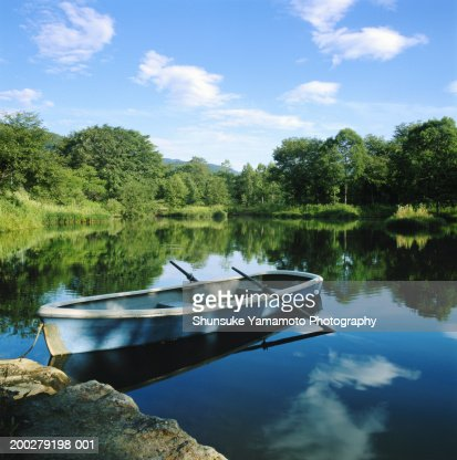 Row boat in pond : Stock Photo