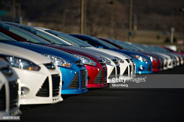 A row of 2014 Ford Ford Motor Co Focus vehicles sit on display at Uftring Ford in East Peoria Illinois US on Saturday Nov 30 2013 Automakers entered...