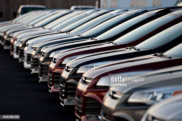A row of 2014 Ford Motor Co Focus vehicles sit on display at Uftring Ford in East Peoria Illinois US on Saturday Nov 30 2013 Automakers entered their...