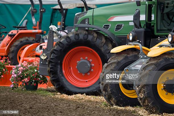 Row of agriculture machinery in grass