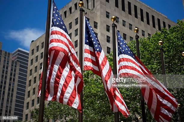 Row of American flags at Rockefeller Center, New York City, NY, USA