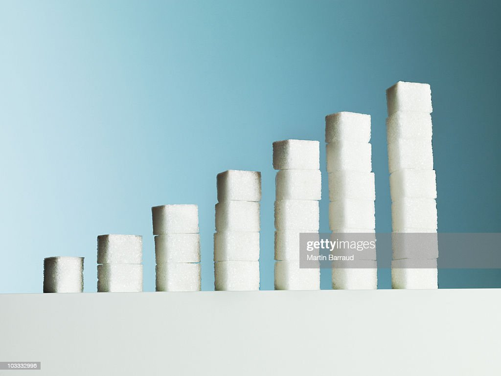 Row of ascending stacks of sugar cubes