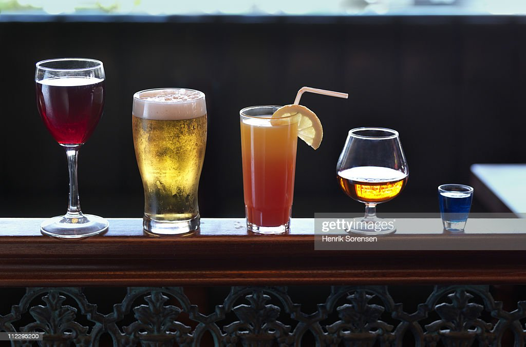 Row of assorted drinks in a bar : Stock Photo