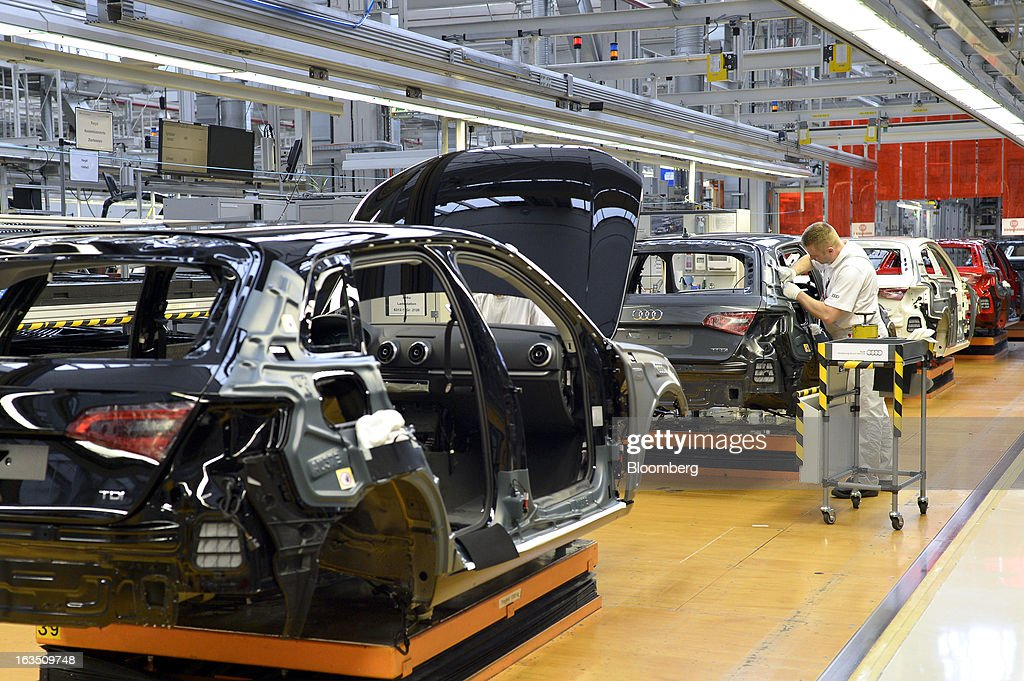 A row of Audi A3 automobiles, produced by Volkswagen AG's Audi brand, move along the production line at the company's plant in Ingolstadt, Germany, on Monday, March 11, 2013. Audi, the world's second-largest maker of luxury vehicles, plans to spend 13 billion euros ($17 billion) through 2016 to develop new cars and expand production capacity as it pursues Bayerische Motoren Werke AG's sales lead. Photographer: Guenter Schiffmann/Bloomberg via Getty Images