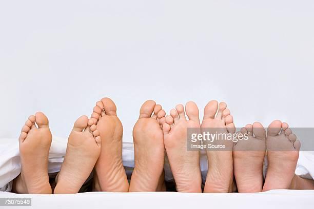 A row of bare feet