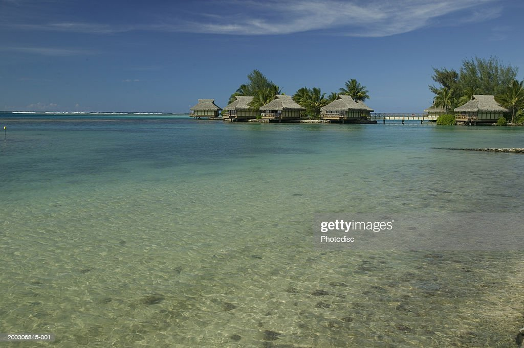 Row of beach houses in tropical setting : Stock Photo