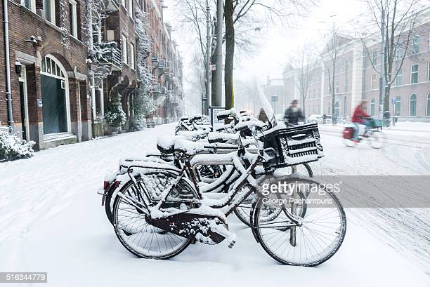 Row of bicycles in snow