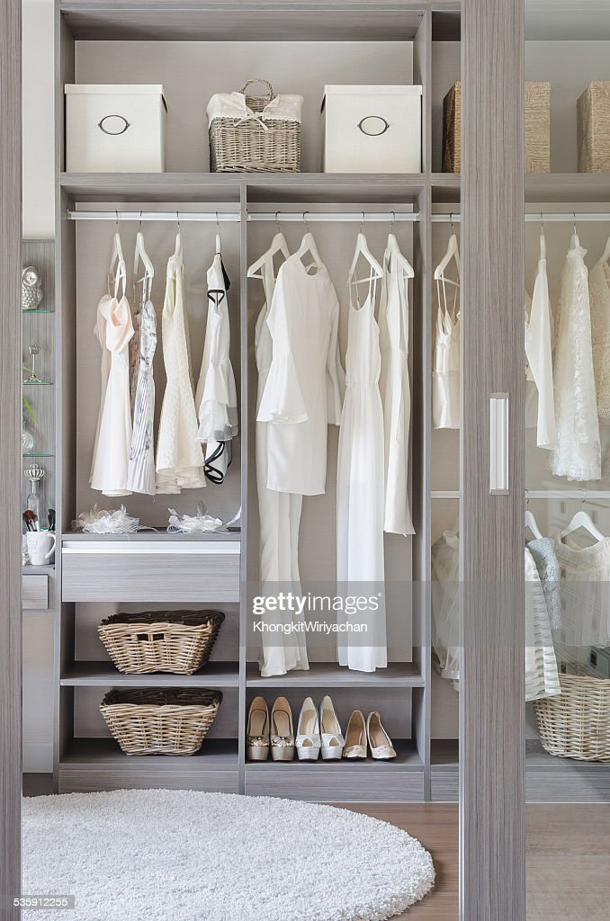 row of black and white dress with shoes in wardrobe : Stock Photo