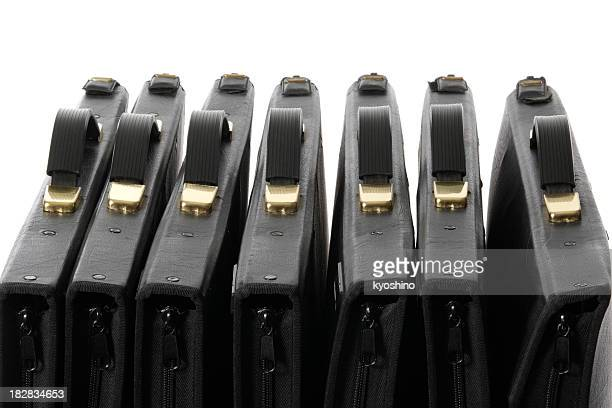 Row of black portfolio against white background