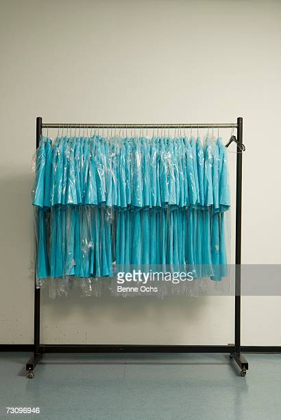 Row of blue shirts hanging on clothes rack