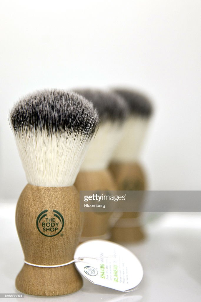 A row of Body Shop men's shaving brushes, branded with the company logo, are seen on display at a store in Paris, France, on Wednesday, Nov. 21, 2012. Body Shop International Plc Chief Executive Officer Sophie Gasperment has introduced organic lines and updated products like Hemp Hand Protector with Community Fair Trade ingredients after L'Oreal, the world's largest maker of cosmetics, bought the company in 2006. Photographer: Balint Porneczi/Bloomberg via Getty Images