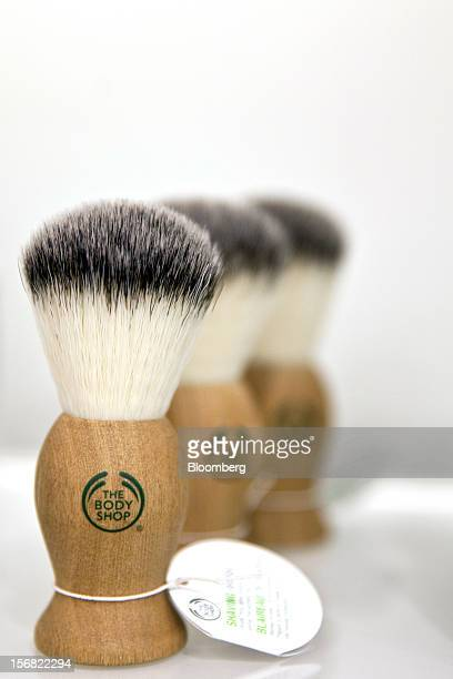 A row of Body Shop men's shaving brushes branded with the company logo are seen on display at a store in Paris France on Wednesday Nov 21 2012 Body...