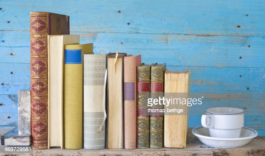 row of books with bookmarks and a coffee cup : Stock Photo