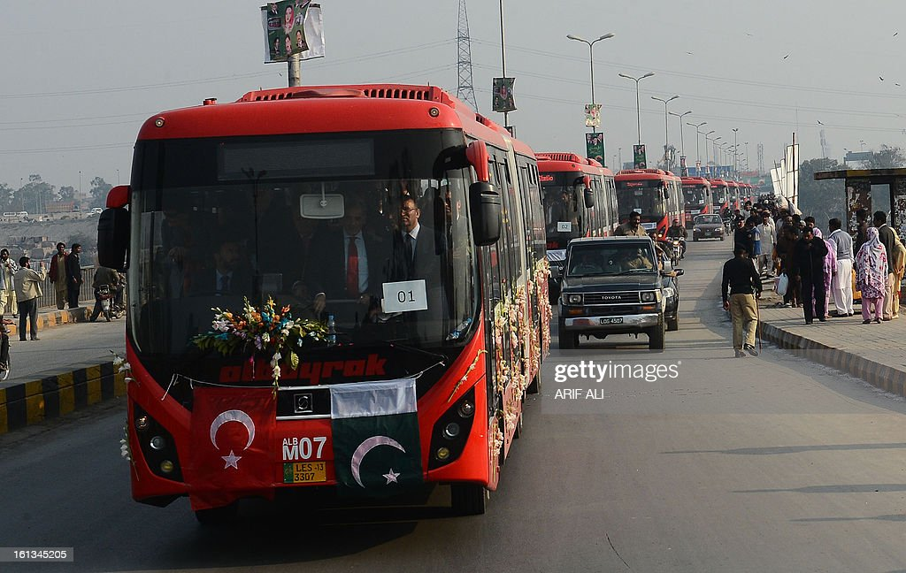 A row of brand-new Metrobuses travel to the launch ceremony of the Metro Bus system in Lahore on February 10, 2013. Authorities in Pakistan on Sunday launched a 'Metro Bus' system in the second largest city, Lahore, the restive country's first major urban public transport scheme. AFP PHOTO/Arif ALI