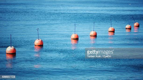 Row Of Buoys In Sea