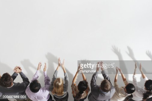 Row of businesspeople applauding, elevated view : Stock Photo