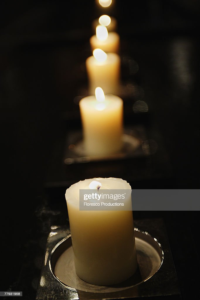 Row of candles burning : Stock Photo