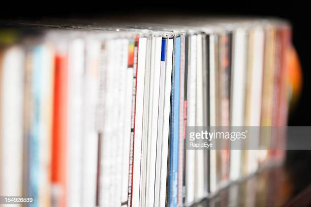Row of CDs on shelf
