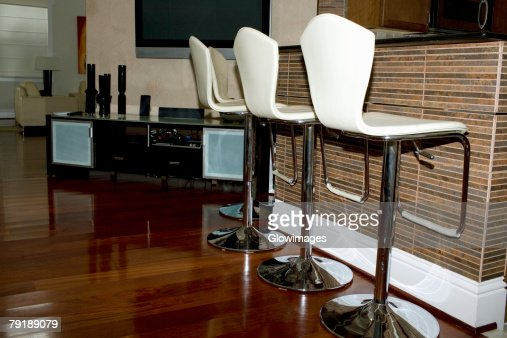 Row of chairs at a domestic kitchen : Stock Photo