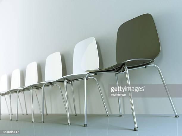 A row of chairs leaning against the wall