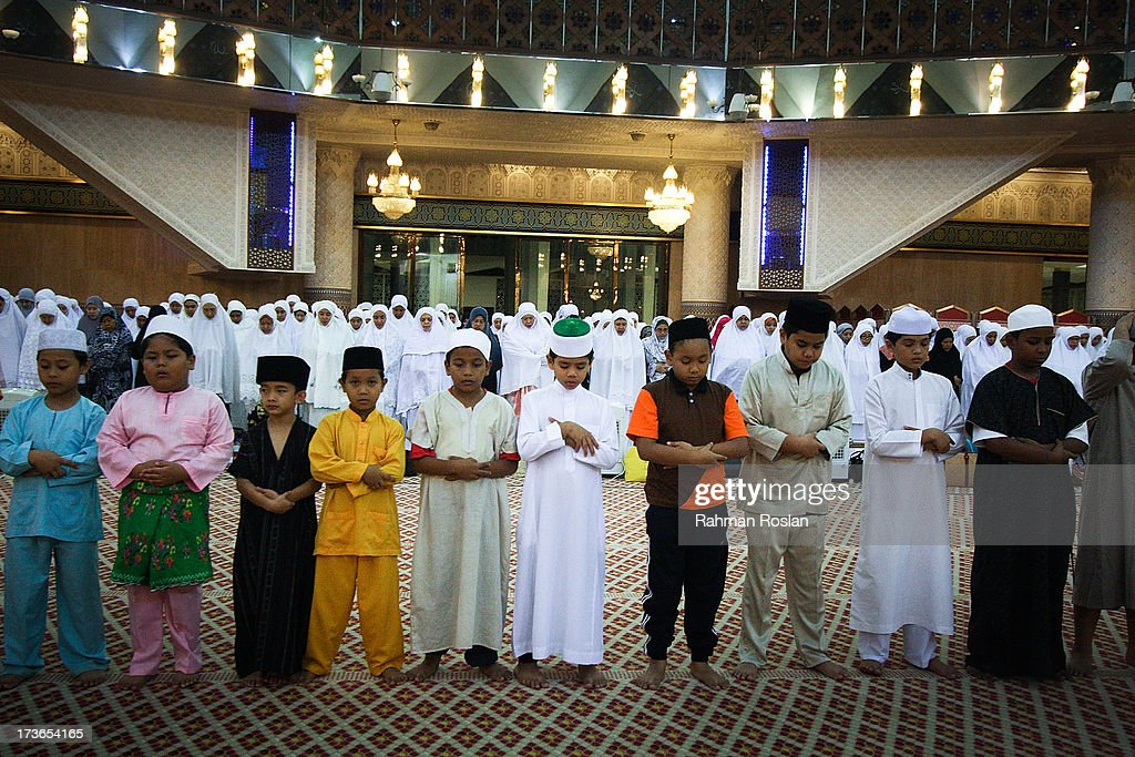 A row of childrens join the night prayer known as Tarawikh as millions of Muslims observe the holiday of Ramadhan on July 16, 2013 in Kuala Lumpur, Malaysia. During Ramadhan, Muslims refrain from consuming food, drinking liquids, smoking, swearing, and engaging in sexual relations from dawn till sunset.