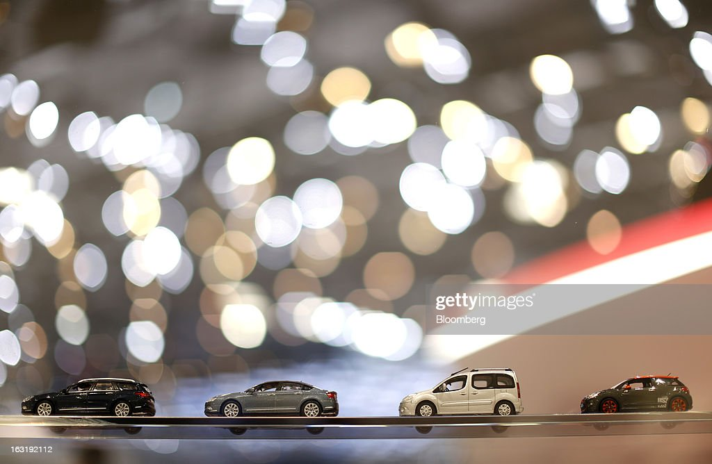 A row of Citroen toy automobiles are seen on display on the PSA Peugeot Citroen stand on the first day of the 83rd Geneva International Motor Show in Geneva, Switzerland, on Tuesday, March 5, 2013. This year's show opens to the public on Mar. 7, and is set to feature more than 100 product premiers from the world's automobile manufacturers. Photographer: Valentin Flauraud/Bloomberg via Getty Images