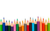 Row of color pencil on white background