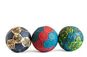 Row of three dirty handball balls isolated on white, colorful, covered with handball resin, used during game play