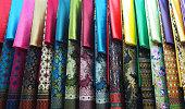 row of colorful set Kebaya skirt dress in local market display