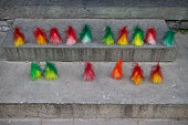 A row of coloured jianzi shuttlecocks on display during morning exercises in Beihai Park an imperial garden to the northwest of the Forbidden City in...