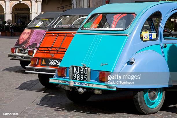 Row of colourful cars at Citroen 2CV rally.
