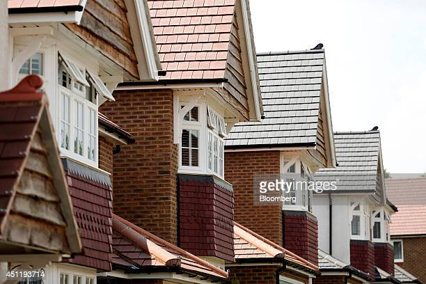 A row of completed new homes stand at a residential housing development site in Crawley Down UK on Tuesday June 24 2014 UK house prices remain below...