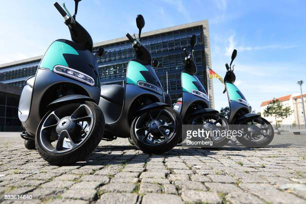 A row of Coup eScooter electric hire vehicles operated by Robert Bosch GmbH stand in Berlin Germany on Thursday Aug 17 2017 Coup is one of Boschs...