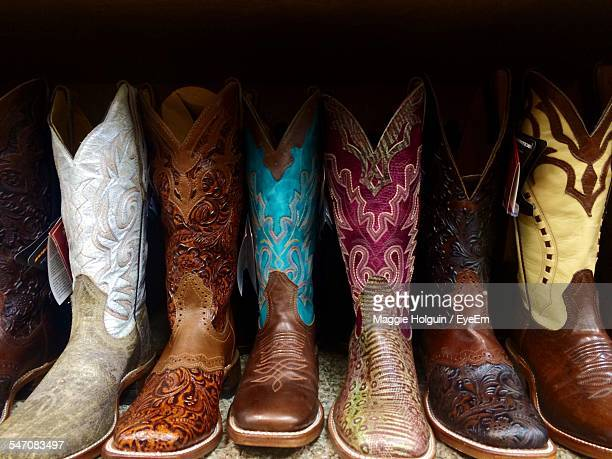 Row Of Cowboy Boots On Shelf