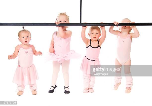 A row of cute baby dancers as ballerinas