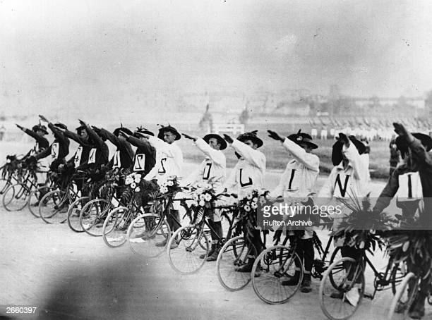 A row of cyclists saluting Italian dictator Benito Mussolini
