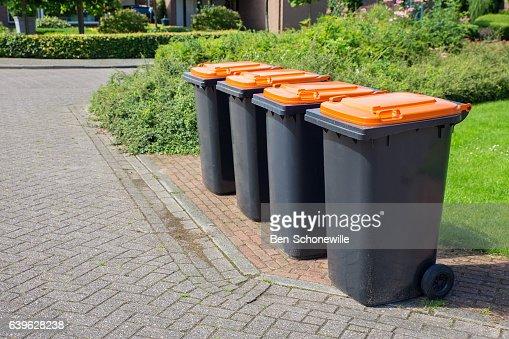 Row of dutch grey waste bins along street : Stock Photo