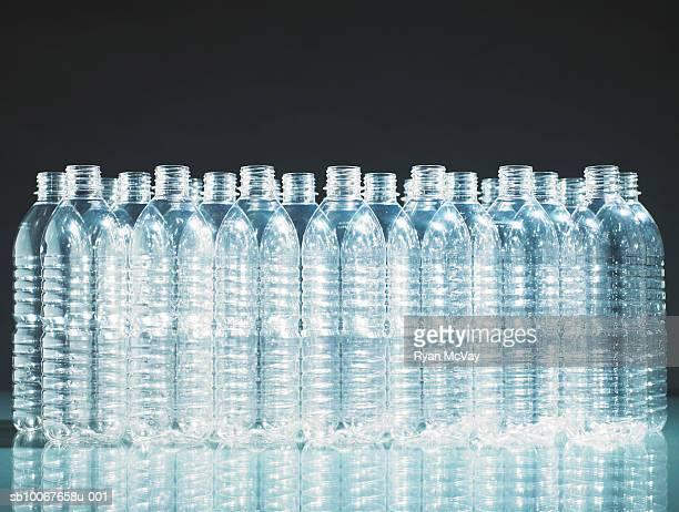 Row of empty plastic bottles