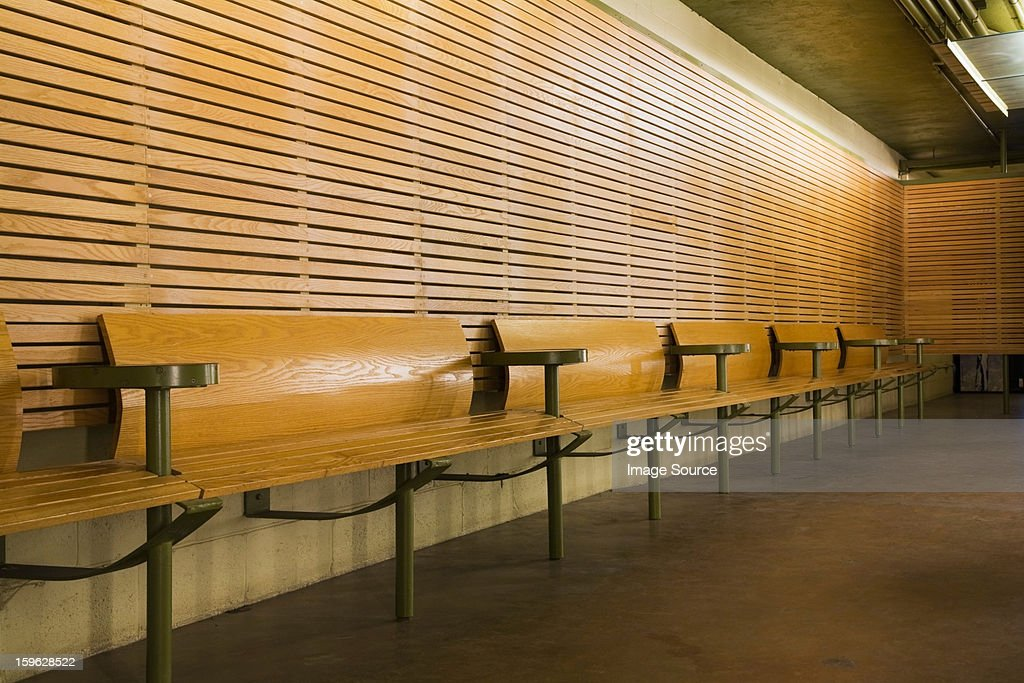 Row of empty wooden benches : Stock Photo