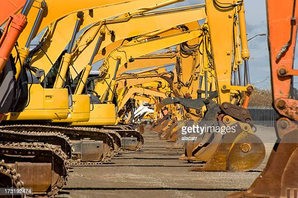 Row of excavators at work site