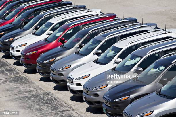 A row of Fiat Chrysler Automobiles 2017 Jeep Cherokee vehicles are displayed for sale at a car dealership in Moline Illinois US on Saturday July 1...
