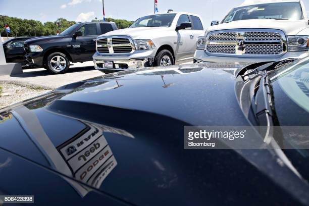 A row of Fiat Chrysler Automobiles Dodge Ram trucks sit on display at a car dealership in Moline Illinois US on Saturday July 1 2017 Ward's...