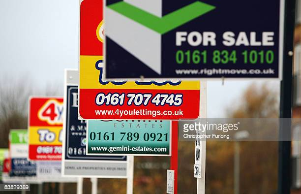 A row of for sale and to let signs stand outside a housing development on November 26 2008 in Salford Greater Manchester England The United Kingdom's...